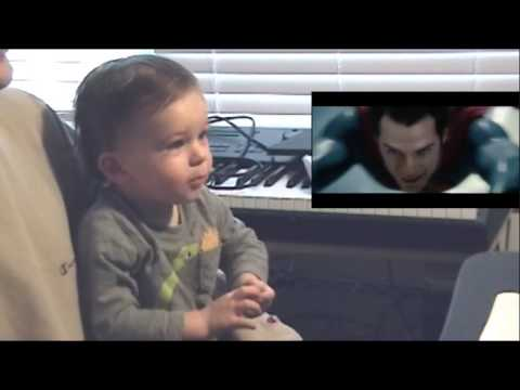 Baby watches Superman fly in
