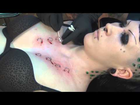 Corset Piercing on Chest Performed By: Andi Smith