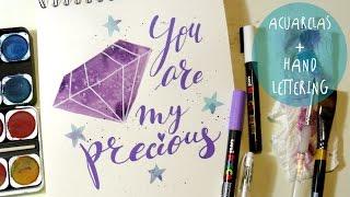 """Hola Fantasticos amigos en este tutorial de pintura vamos a utilizar las acuarelas para pintar piedras preciosas en forma geometrica y para crear decoraciones para la casa o para personalizar una agenda.Vamos tambien a escribir una frase en estilo """"hand lettering"""" (caligrafia moderna).My INSTAGRAM: https://www.instagram.com/fantasvale/My FACEBOOK: https://www.facebook.com/Fantasvale/"""