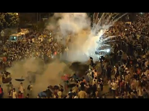 tear - Hong Kong riot police fired teargas, pepper spray for the first time since 2005 to disperse pro-democracy demonstrators during clashes after thousands of protesters blocked the main street...