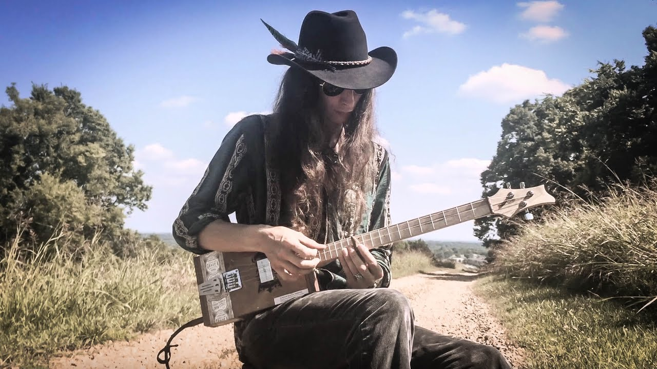 """Playing Slide Guitar with a River Stone 