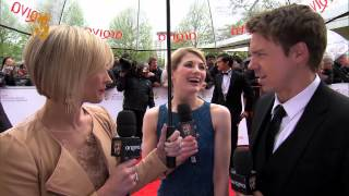 Broadchurch stars Jodie Whittaker & Andrew Buchan talk to Jenni Falconer on the red carpet at the Arqiva British Academy...