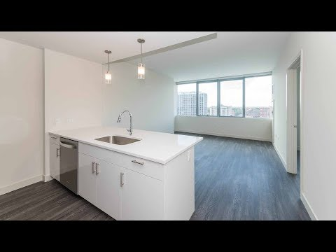 A sunset-view one-bedroom at the new Eight Eleven Uptown apartments