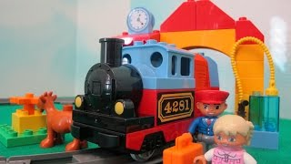 """This time I am unboxing the Lego Duplo train set. This set includes the train, track, a little girl passenger and her goat, a train conductor, bricks for building a train station. The train requires 3 AA batteries that are not included.Check out my other fun toy videos:Opening 8 Transformers Rescue Bots Playskool Heroes""""http://youtu.be/Yc03l9Z8H-c""""Review of Bumblebee Transformer Rescue Bot Playskool Heroes""""http://youtu.be/zAk83z3iNrk""""Playing Disney Sofia The First Forest Playset""""http://youtu.be/9gYcPLm6QiI""""Opening Shopkins 12 pack Shopkins Small Mart""""http://youtu.be/_JW85iERzb8""""Watch Assembling and Playing the Design And Drift Speedway Track Set With Micro Drifters Lightning McQueen and Dinoco Cars""""http://youtu.be/AEhokIcYRGU""""Unboxing Disney Fairies Tink's Bling Boutique with Tinker Bell""""http://youtu.be/ccYSH2YIkj4""""Unboxing Doc McStuffins Doctor's Bag Set""""http://youtu.be/qtxCtPUX6kw""""Unboxing the Play Doh Doctor Drill 'n Fill Toy""""http://youtu.be/D_yyhWqTNr0""""Shopkins 5 Pack With Hidden Shopkin Opening""""http://youtu.be/GSeBRWffKFg""""Playing Disney Princess Palace Pets Pamper and Beauty Salon""""http://youtu.be/6WMJEdnfqkM""""Opening 4 Blind Pack Surprise MashEms from Disney Pixar Movies""""http://youtu.be/HwTwORxqrQ4""""Playing Stunt Racers Mater, Lightning McQueen, Jeff Gorvette""""http://youtu.be/le-5UyhJqw4"""""""