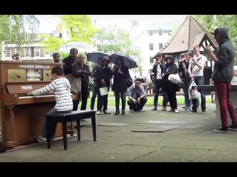 11 year old George plays Moonlight Sonata (3rd mov) on a Street Piano in the rain.