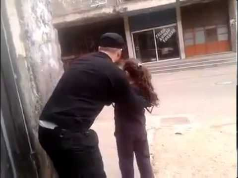 Soliders teaching a little girl to shoot gun in Tripoli