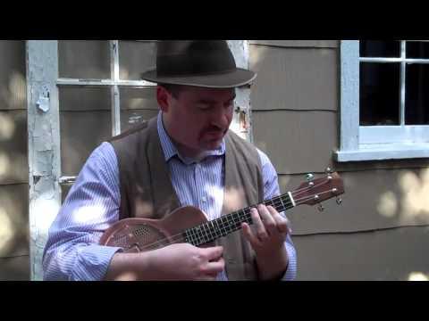 Steve Boisen of The Barnkickers tries out a Gold Tone resonator uke