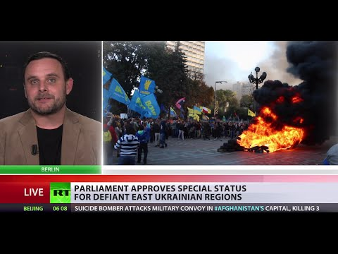 politics - Ukrainian MPs have adopted a law that bans the closest allies of Ukraine's deposed President Yanukovich from politics. Meanwhile, a rally outside the Ukrainian parliament building has turned...