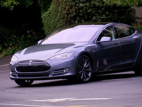 tesla - http://cnet.co/1kE5wQT CNET revisits the Tesla Model S now that it's a bona fide mass production hit, explore drive-by-wire technology, and learn how technology can only partly neutralize those...