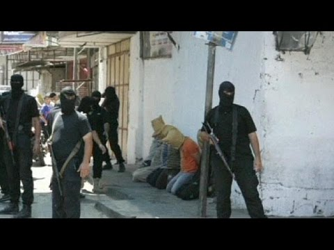 YouTube - Hamas-led gunmen in Gaza have executed 18 Palestinians accused of helping the Israelis. Hooded and bound, seven of them were shot dead in front of worshippers outside a mosque in one of Gaza's...