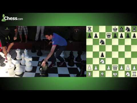 im - Who said chess wasn't a contact sport? Watch the bodies and pieces fly as super grandmaster Maxime Vachier-Lagrave takes on Chess.com's IM Daniel Rensch in a giant chess bullet game outside...