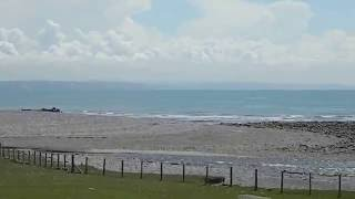 Towyn United Kingdom  city photo : Tonfannau beach, camp remains, Tywyn and distant Llyn Gwynedd Wales UK
