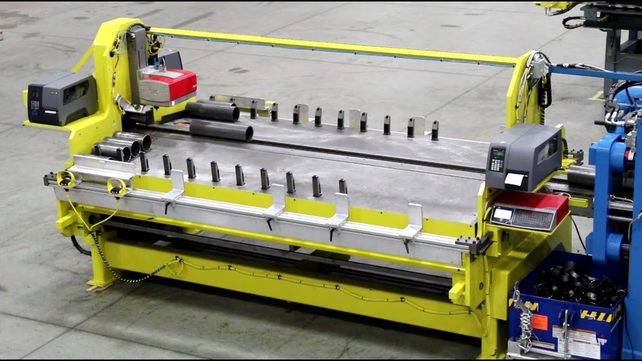 Hautau tube unloading and stamping systems