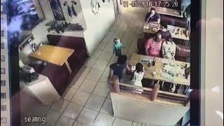 Caught on film: Stranger snatches child at restaurant