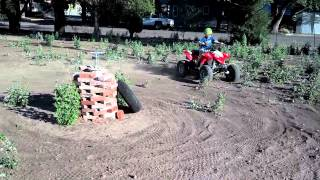8. 5 year old on his outlaw 90cc atv