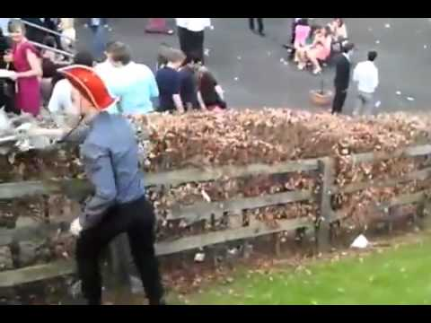 Drunk Irish man tries to walk up a hill, Everyone cheers him on!