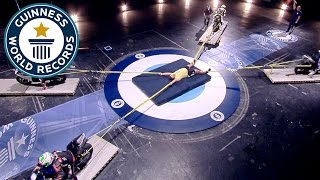 Video Longest duration restraining four motorcycles - Guinness World Records MP3, 3GP, MP4, WEBM, AVI, FLV September 2017