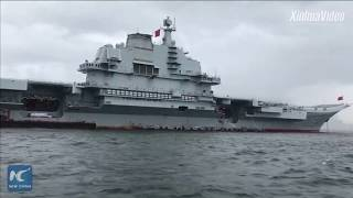 Getting aboard China's aircraft carrier Liaoning, anchored in open sea area outside Victoria Harbour in Hong Kong.