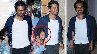 Bollywood actor Nawazuddin Siddiqui attended the special screening of 'Munna Michael' with his cute shy daughter Shora at The View in Mumbai. At the screening, Nawazuddin Siddiqui's daughter Shora was still not ready for all the media attention and was seen shying away from the cameras. Must watch! Watch latest Bollywood gossip videos, latest Bollywood news and behind the scene Bollywood Masala. For interesting Latest Bollywood News subscribe to Biscoot TV now : http://www.youtube.com/BiscootTVLike us on Facebookhttps://www.facebook.com/BiscootLiveFollow us on Twitterhttp://www.twitter.com/BiscootLiveFor Latest Bollywood News Subscribe us on Youtube http://www.youtube.com/c/BiscootTVCircle us on G+ https://plus.google.com/+BiscootLiveFind us on Pinteresthttp://pinterest.com/BiscootLive