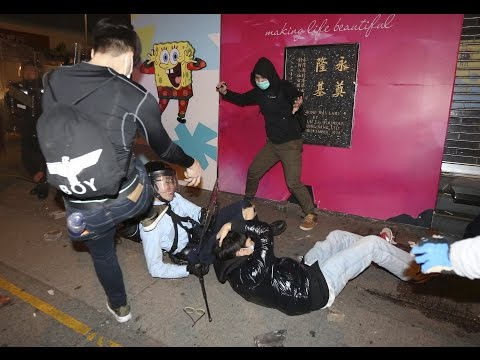 Protesters in Hong Kong clashed with police in violent demonstrations over the removal of illegal street vendors in the city's Mong Kok neighbourhood.