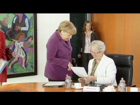 Merkel supports minister in cheating row