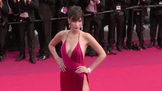 Video Bella Hadid stuns in Red on the red carpet for the Premiere of La Fille Inconnue in Cannes MP3, 3GP, MP4, WEBM, AVI, FLV Mei 2017
