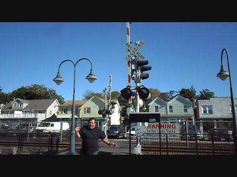 railroad crossing - This is a video I made while on vacation in the Northeast in New Jersey at the NJ Transit rail station in Elberon New Jersey of a pedestrian railroad crossin...