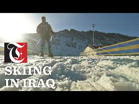 Iraqis hit the slopes of Korek Mountain near Erbil for the earliest snowfall, despite ongoing fighting in nearby Mosul.