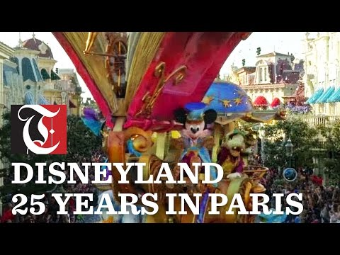 Disneyland Paris holds grand parade to celebrate the park's 25th anniversary.