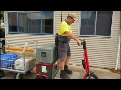 Skatework Tug Towing a Cage Basket Trolley