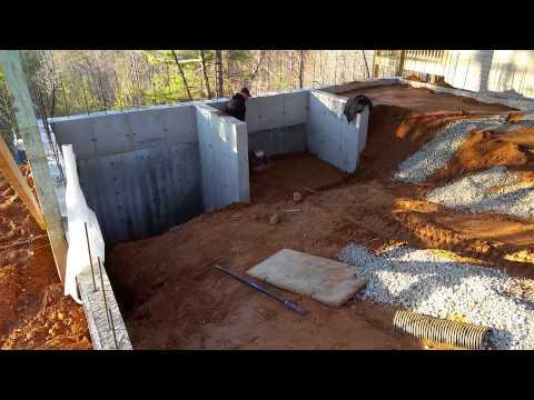 Backfilling Garage retaining walls and compacting
