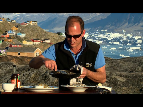 Chris cooking sardines - A Taste of Greenland