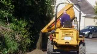 Hitachi MiniDigger and a Thwaites Dump Truck involved in clearing a driveway.