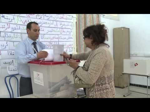 Tunisia votes in landmark presidential election.