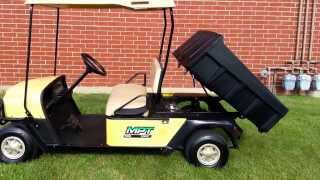 8. EZGO MPT 1000E Utility Golf Cart with Dump Box