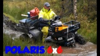 2. Awesome Polaris 6x6 Sportsman 500 ATV in the woods and in the mud 6 six wheeler with chains