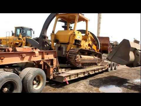 983 cat  catrepillar being unloaded to be scraped to heavy for loader