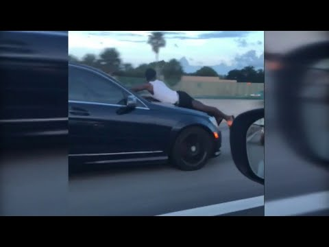 Video Driver records man riding on hood of car down I-95 in Miami download in MP3, 3GP, MP4, WEBM, AVI, FLV January 2017