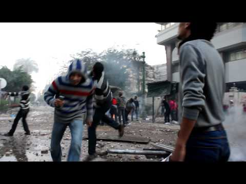 Egyptian security, protesters clash while youth mourn