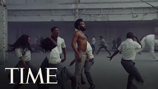 Video An Expert's Take On The Symbolism In Childish Gambino's Viral 'This Is America' Video | TIME MP3, 3GP, MP4, WEBM, AVI, FLV Mei 2018