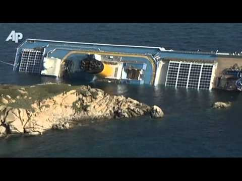 ship runs aground - Survivors from a luxury cruise ship that ran aground and tipped over, leaving at least three dead and 69 people still unaccounted for, described Saturday a c...