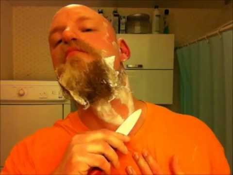 Man shaves beard with cheap ceramic knife