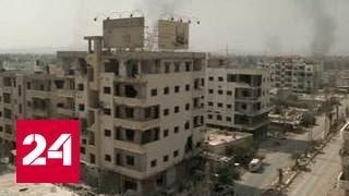 Сирийские боевики с семьями уезжают из Дарайи