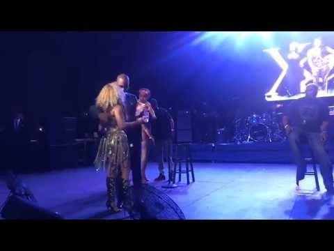 TINY HARRIS KISSES TI ON STAGE AND SINGS TO HIM