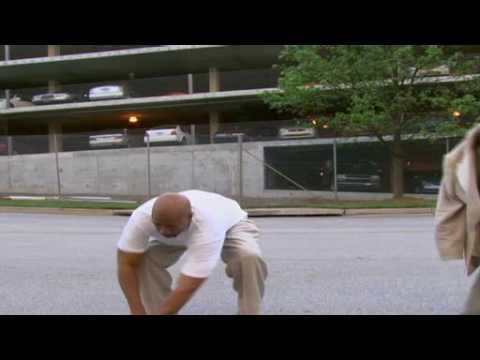 Kenny Smith tries to jump over  car with