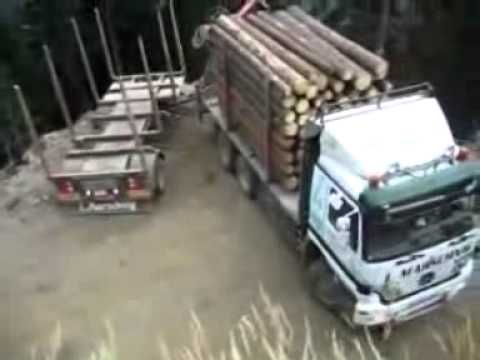 extreme driving - Jak to taky lze otočit :-)Hazardous cargo rigs turning on a steep slope. Car wood, forest road, danger, courage, experience Narrow Road, high hills.