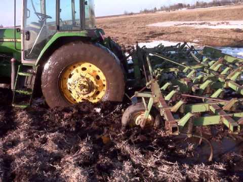 Tractors stuck in the mud.