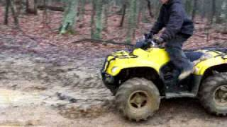 10. mud boggin on suzuki eiger 400 built like hell