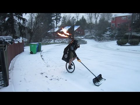 The Unipiper Dresses as Darth Vader and Shovels Snow While Playing His Flaming