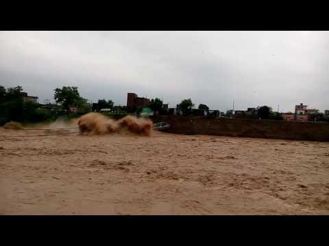 Moment A Suspension Bridge Collapses During A Massive Flood